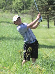 Brighton freshman Davis Codd hits out of trouble on his way to an 80 in the KLAA golf tournament at Salem Hills Golf Club on Thursday, May 24, 2018.