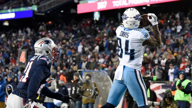 Titans wide receiver Corey Davis (84) goes up for a touchdown catch during the fourth quarter Saturday.