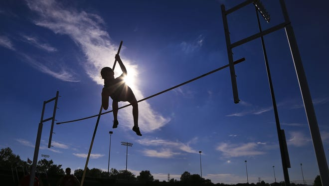 The Oldham County girls and Trinity boys took the titles at the Class 3A, Region 4 track and field meet.