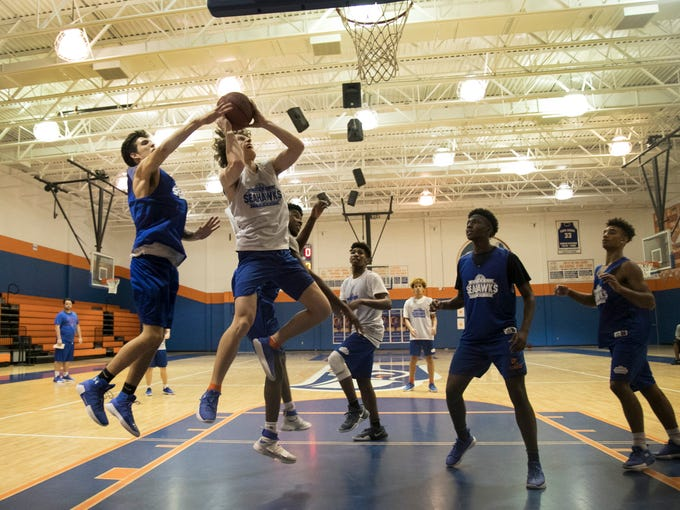 Travis Thomas goes up for a shot during basketball