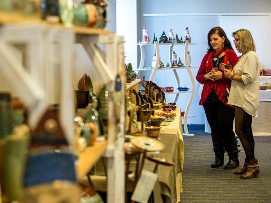 Potters Brenda Kasten, of Avoca, and Maureen Dunsmore,