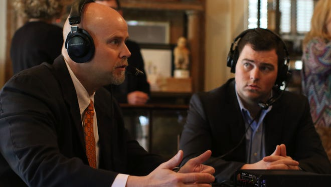 Police jurors Walt Caldwell, left, and Scotty Robinson, right, speak during a radio interview at Governors Cigar & Pipe on Friday.