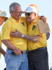 Former Eastside coach Ed Boehmke, left, embraces former long-time Berea coach Jim Mattos during a ceremony naming the Eastside track after Boehmke during day two of the Greenville County Track and Field Championships at Eastside High on Tuesday, April 17, 2018,