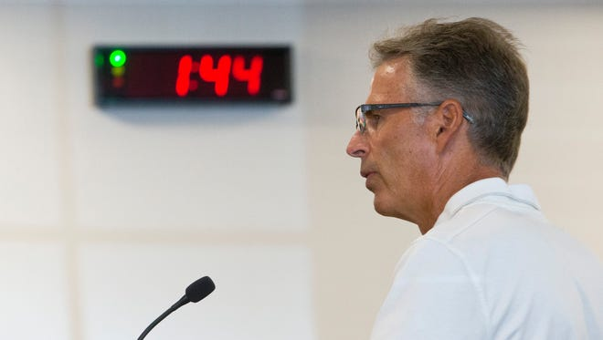 A timer counts down the allotted time to speak as Estero resident Doug Saxton informs the Village Council of an upcoming event him and his wife are planning to be held in the community during a Village of Estero Council Meeting Wednesday, July 6, 2016 in Estero, Fla. The recently installed timer, which counts down from three minutes, is a helpful tool to keep presentations prompt and the meetings running smoothly. (Luke Franke/Naples Daily News)