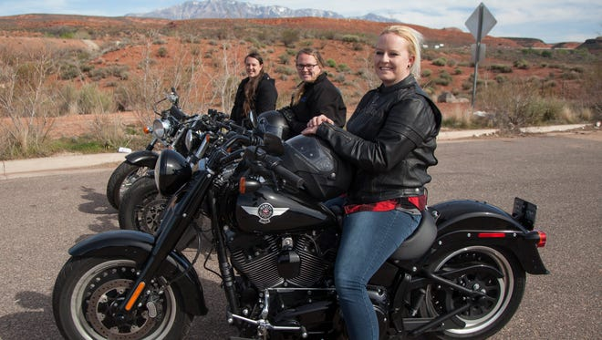 Members of the St. George branch of The Litas, an all-female motorcycle group, prepare for one of their rides Saturday, March 18, 2017.