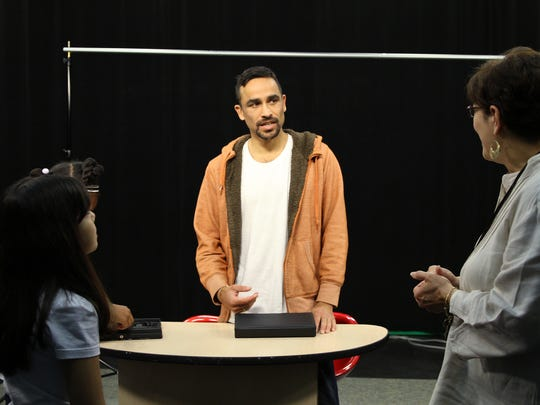 Rajesh Barnabas, producer-director at Rochester Community Television, talks with School 9 teacher Alba Pacheco after she and three students finished doing their MLK Kids News program at RCTV.
