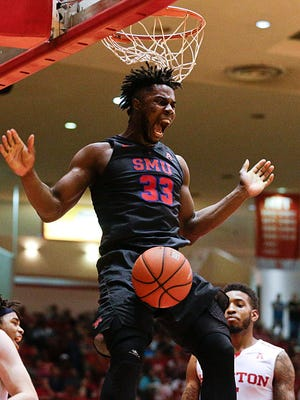 Southern Methodist Mustangs forward Semi Ojeleye (33) dunks against the Houston Cougars in the first half at Hofheinz Pavilion.
