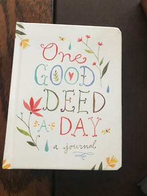 One Good Deed A Day, by Chronicle Books, might just hold the cure to the post-holiday blues.