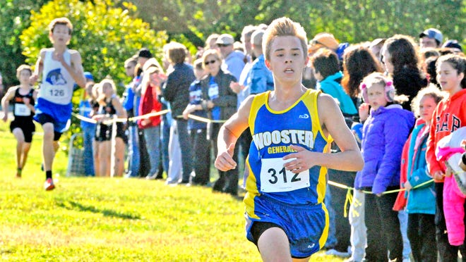 Ashton Dunlap (shown during the 2019 Wayne-Holmes Invite) and Wooster will be able to run after all before Oct. 1, with Wooster High School reversing its decision to postpone cross country and volleyball after clarification from the Ohio Department of Health on each sport.