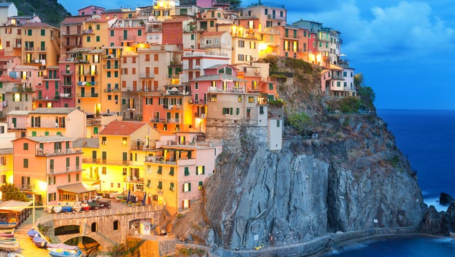 Colorful houses at night in Manarola in Cinque Terre, Italy.