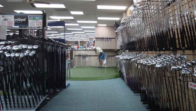 A wide variety of clubs are displayed at Lumpy's Discount Golf in Fort myers.