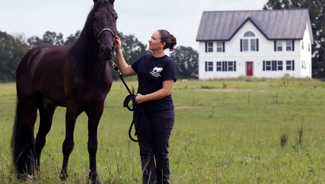 Tawnee Preisner, founder of Horse Plus Humane Society, with Skywalks Magical Dream Tuesday September 13, 2016.