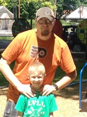 Brian Kutys, 36, Lebanon, and his 7-year-old son, Riley.