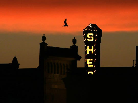 The marquee for the Stefanie H. Weill Center for the Performing Arts peeks into a summer sunset as a seagull flies nearby Thursday July 21, 2016 in Sheboygan.