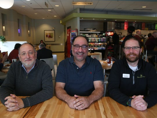 Paul Rottenberg, president of Orchestrate Hospitality, George Formaro, Orchestrate Hospitality chef and restaurateur, and David Clemens, Gateway Market store director, pose for a photo inside the Gateway Market cafe on Wednesday, April 26, 2017, in Des Moines. The grocery store and cafe celebrated its 10th anniversary in April.