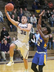 Lexington's Cade Stover makes a jump shot in front