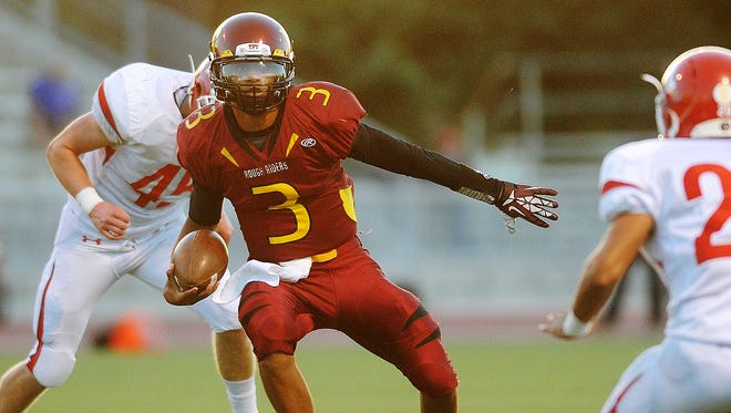 Roosevelt's Taryn Christion looks for room to run during a game against Lincoln at Howard Wood Field last season.