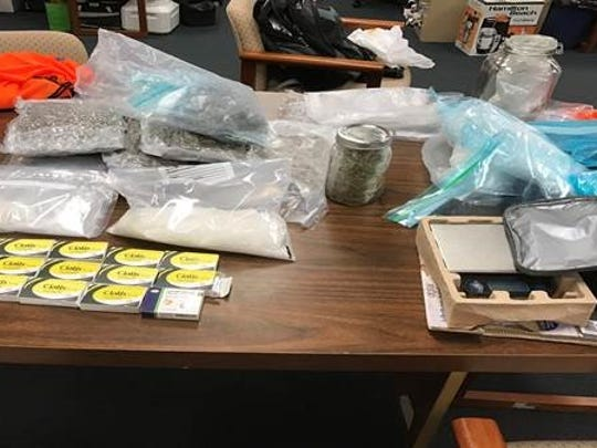 Indianapolis police arrested William Kinslow after he received and opened a box he thought contained drugs, Thursday, March 9, 2017. Police ended up seizing the cash, gun, around 6 pounds of suspected marijuana and 1 kilogram of suspected methamphetamine.