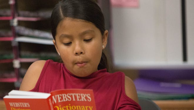 Priscilla Rios, 9, reads the inside cover of her dictionary that has the Rotarian rules printed on it. Rios took part in dictionary day at Monte Vista Elementary School, Tuesday, March 27, 2018. The Rio Grande Rotary Club donated 2,200 dictionaries to third-grade classes throughout the district, as it has been doing for 11 years.
