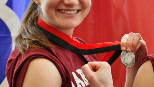 Julia Baumel rows for the Newport Rowing Club.