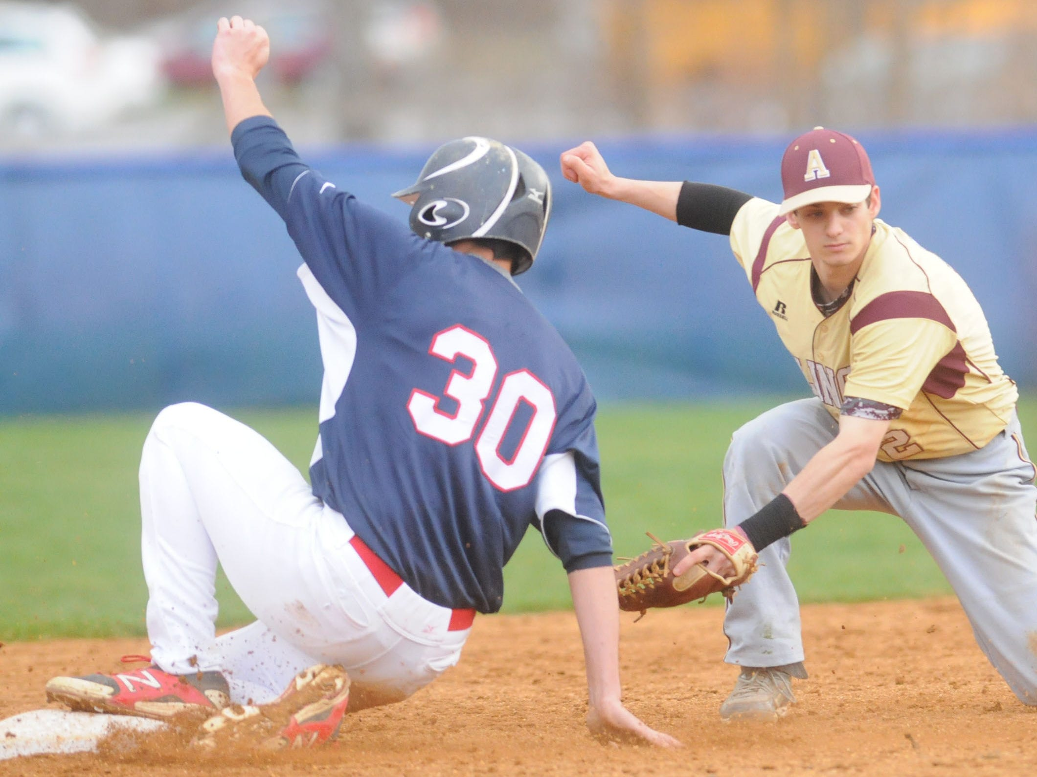 Ketcham's Brian Santiago, left, slides into second base while Arlington's Steve Gerringer, right, tries to make the tag.