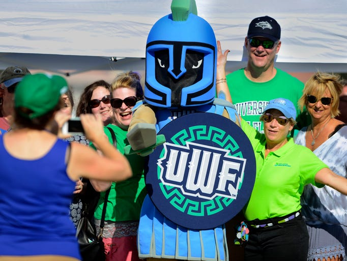 West Florida football fans pose for a photo with UWF