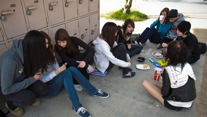 Cactus Shadows High School  students  eat lunch on the ground near lockers on Feb. 1, 2012.
