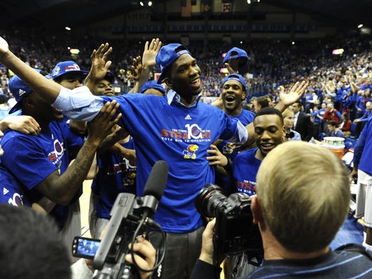 Kansas Jayhawks center Joel Embiid (center) celebrates after the game against the Texas Tech Red Raiders at Allen Fieldhouse. Kansas won the game 82-57.