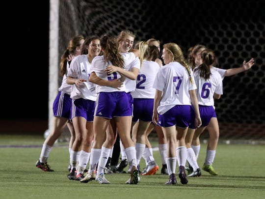 Shasta girls soccer players celebrate the win on Tuesday night.