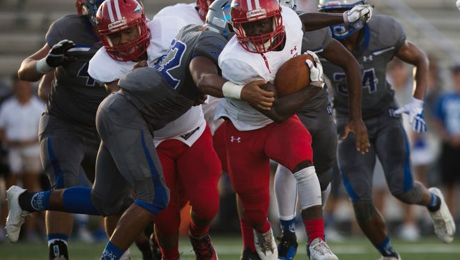 Immokalee's Fred Green (1) carries the ball against Barron Collier High during the first half of action at Barron Collier High School Wednesday, September 6, 2017 in Naples. Immokalee would lead 21-14 at the half.