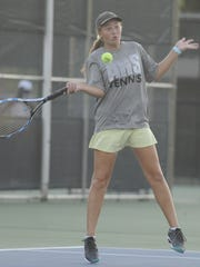 Abilene High's Lauren Schaeffer hits a forehand during a previous match last season.