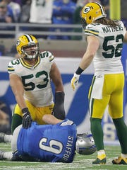 Green Bay Packers outside linebacker Nick Perry (53) celebrates his sack of quarterback Matthew Stafford (9) with outside linebacker Clay Matthews (52) against the Detroit Lions at Ford Field Sunday, January 1, 2017.
