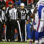 Nov 23, 2015; Foxborough, MA, USA; NFL referee Gene Steratore (114) confers with other officials after a New England Patriots touchdown during the second half against the Buffalo Bills at Gillette Stadium. Mandatory Credit: Winslow Townson-USA TODAY Sports