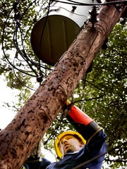 A Lafayette Utilities system lineman is shown in this file photo.