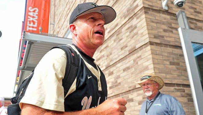 Vanderbilt coach Tim Corbin arrives at the College World Series championship game against Virginia at TD Ameritrade Park in Omaha, Neb., Monday, June 23, 2014.
