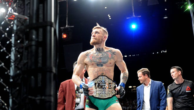 Conor McGregor exits the octogon following his championship victory on Dec. 12, 2015 over Jose Aldo during UFC 194 at MGM Grand Garden Arena.