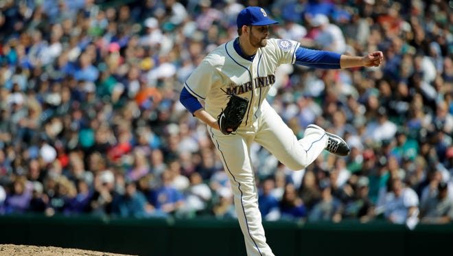 Seattle Mariners starting pitcher James Paxton finishes his delivery as he throws against the Boston Red Sox in the eighth inning of a baseball game, Sunday, May 17, 2015, in Seattle.
