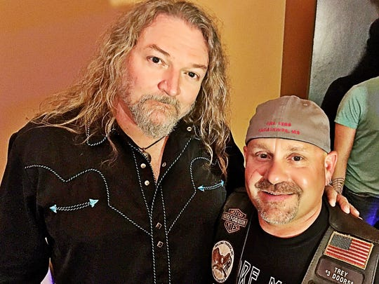 Kentucky Headhunters Trey Clark hangs out backstage with The Kentucky Headhunters' Doug Phelps before the band's show to a packed house at Boogie Nights Tropicana.