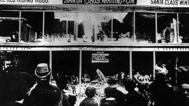 Children of all ages gathered on Fountain Square in 1895 to view the annual Christmas pantomime on the glass-covered balcony of the Mabley & Carew department store.