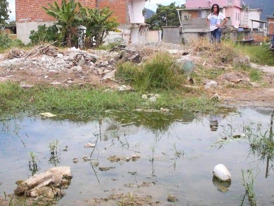 Local resident Sandra Souza overlooks mosquito-infested