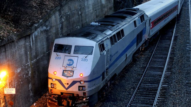 A Metro-North commuter train sits idle just south of the Poughkeepsie train station.