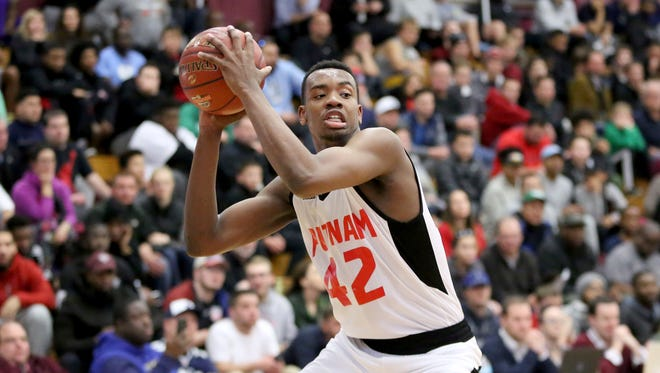 Putnam Science Academy's Malik Ondigo #42 in action against Vermont Academy during a high school basketball game at the 2017 Hoophall Classic on Jan 15, 2017, in Springfield, Mass.