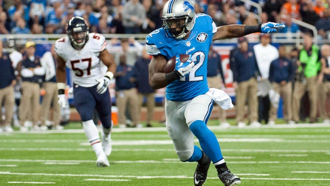 Lions wide receiver Jeremy Ross runs the ball during the second quarter against the Chicago Bears at Ford Field.
