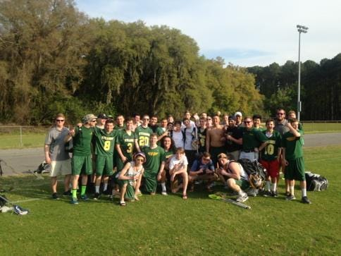 Sycamore's boys lacrosse team celebrates a 12-9 victory over Benedictine Military Academy in Savannah, Georgia over spring break.