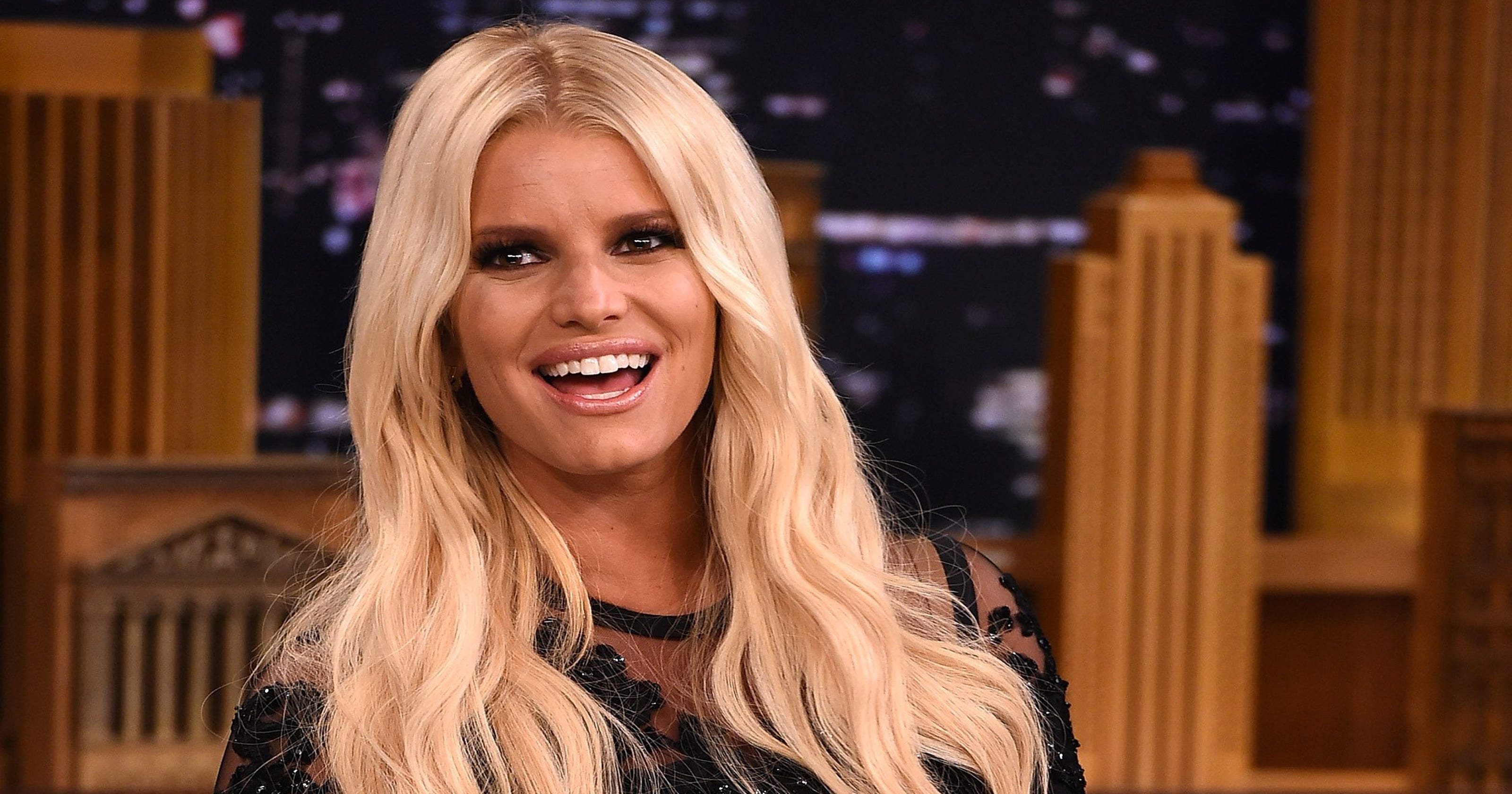 Jessica Simpson marks birthday with topless pool photo
