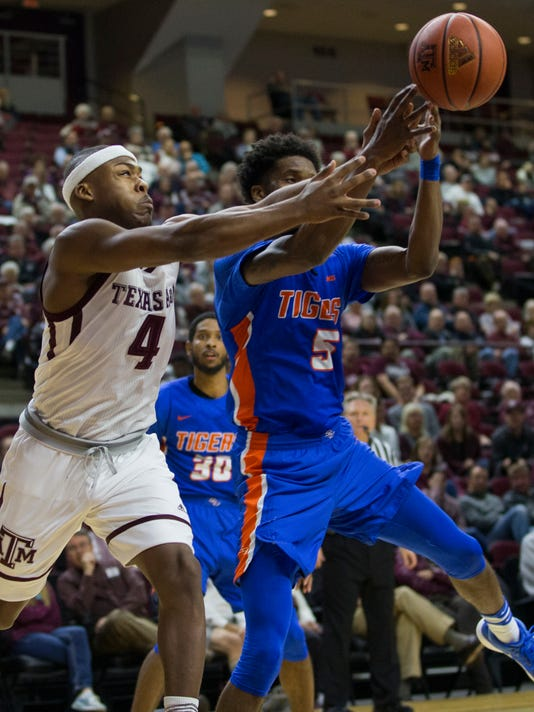 Texas A&M guard JJ Caldwell (4) and Savannah State forward Javaris Jenkins (5) go after a rebound during the first half of an NCAA college basketball game Wednesday, Dec. 13, 2017, in College Station, Texas. (AP Photo/Sam Craft)