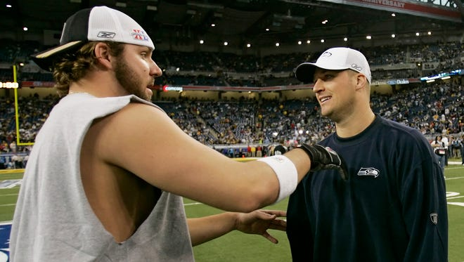 Pittsburgh Steelers quarterback Ben Roethlisberger, left, and Seattle Seahawks quarterback Matt Hasselbeck meet on the field during pregame for the Super Bowl XL football game Sunday, Feb. 5, 2006, in Detroit. (AP Photo/David J. Phillip)