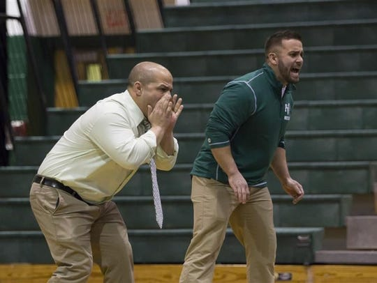 Passaic Valley wrestling coach Joe Benvenuti (left)