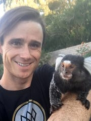 Jason Ellis, 30, of Las Vegas, holds Gizmo, a marmoset