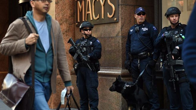 Police officers with the New York City Police (NYPD)  Emergency Services Unit stand guard in front of Macy's at Herald Square on November 20, 2015 in New York. Police officials are on a heightened state after  the Islamic State group released a video using old footage of busy Manhattan streets to threaten an attack.